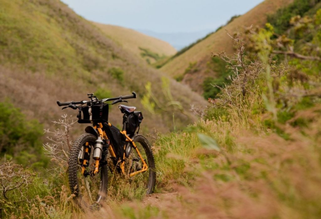 bike parked against a hill in the middle of nature