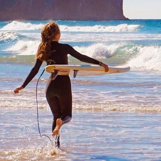 Surf girl is running