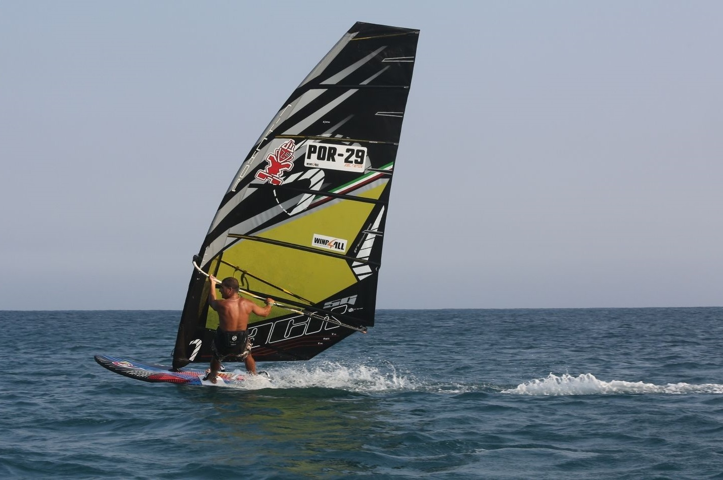 Man windsurfing to the left